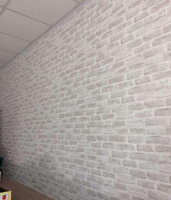Giấy dán tường Hàn Quốc giả gạch trắng mã H6033-1 đang được NND bán với giá 1.100.000đ/cuộn (16.5m2)